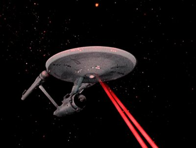 http://blog.fantasyheartbreaker.com/wp-content/uploads/2012/01/Enterprise-Firing.jpg